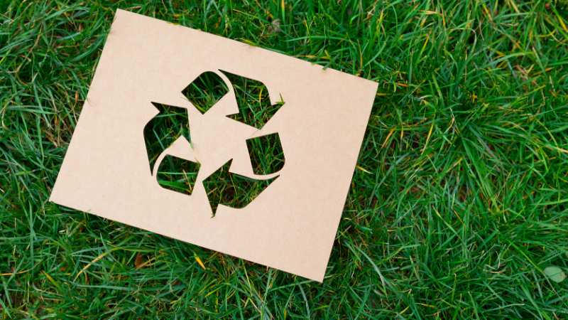 recycling at workit spaces - green grass background with a recycling symbol cutout